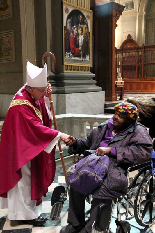 Archbisohp Chaput greets Karen Collins after mass AAAAAAAAAAAAAAAAAAAAAAAAAAAAAAAAAAAAAAAAAAAAAAAAAAAAAAAAAAAAAAAAAAAAAAAAAAA