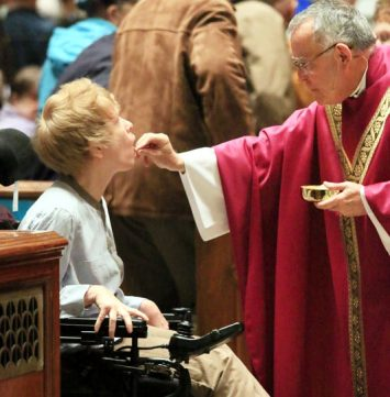 Maria Dewan from St Francis Xavier recives communion from Archbishop Chaput AAAAAAAAAAAAAAAAAAAAAAAAAAAAAAAAAAAAAAAAAAAAAAAAAAAAAAAAAAAAAAAAAAAAAAAAAAAAAAAAA